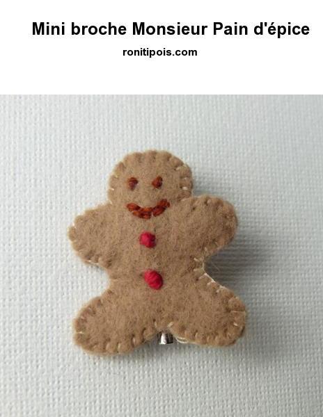 Bonhomme en pain d'épice (gingerbread Man) de feutrine ouatée cousue main avec attache broche couleur argent.