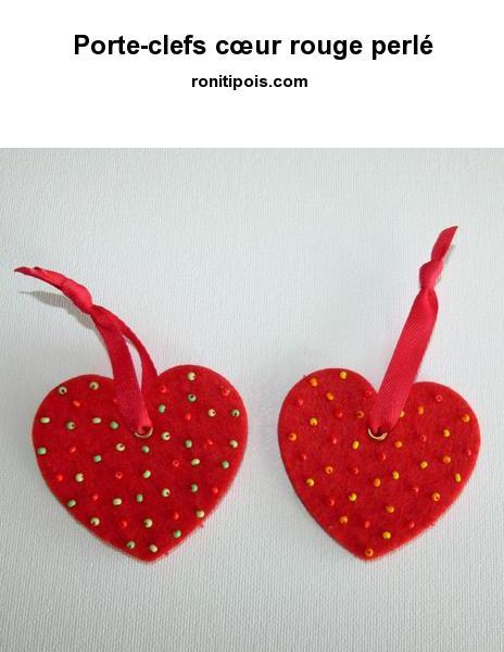 Cœur de feutrine rouge perlé.