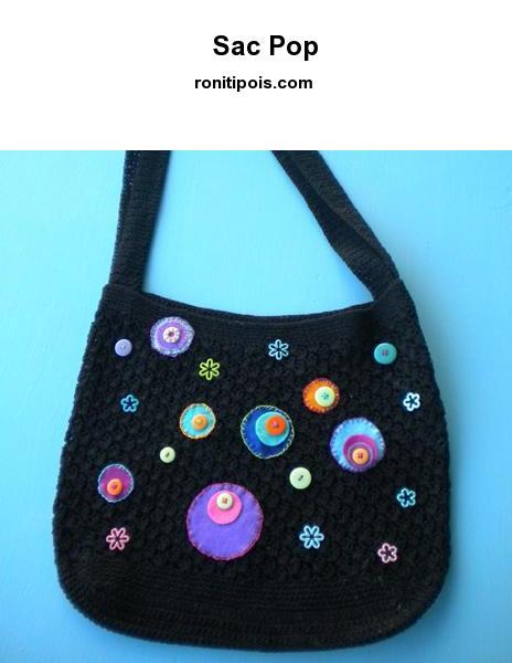 Sac au crochet coton noir à bandoulière, customisé de ronds de couleurs et de fleurs pop.
